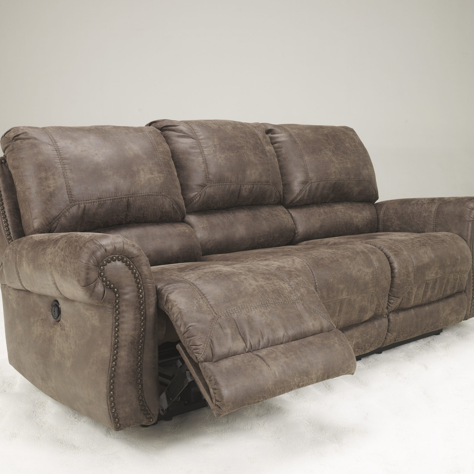 Signature Design Oberson Reclining Sofa Harrington Home Furniture